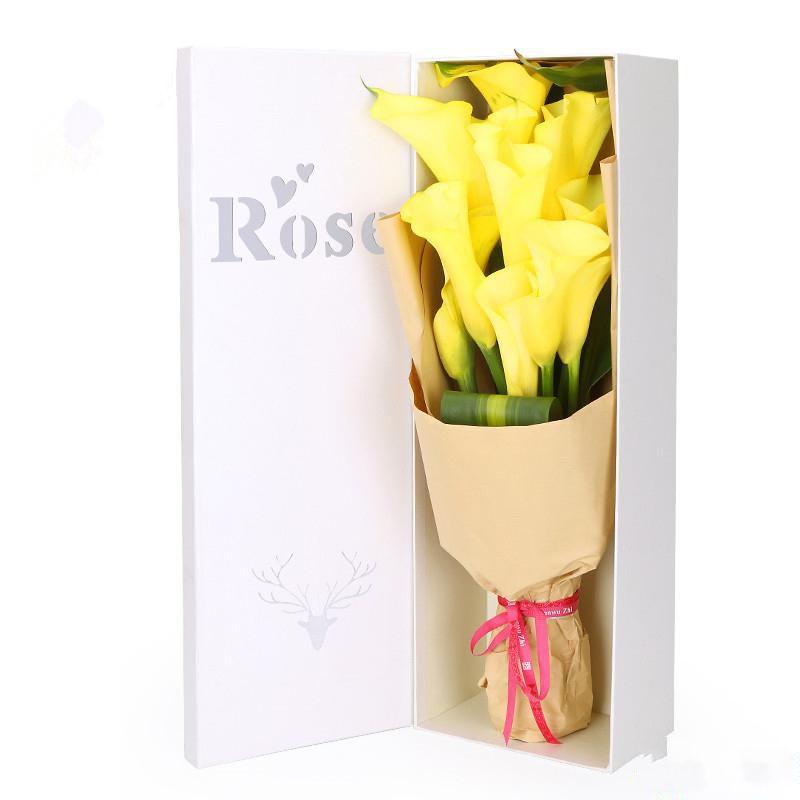 长情陪伴_9枝黄色马蹄莲,搭配适量巴西叶装饰